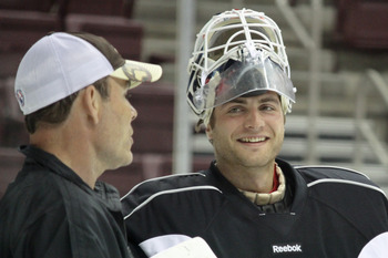 Adam Oates and Braden Holtby at Hershey Bears practice (l-r, sweetesthockeyonearth.com)