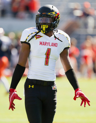 Oct 13, 2012; Charlottesville, VA, USA; Maryland Terrapins wide receiver Stefon Diggs (1) gestures towards a teammate during pregame warm-ups before the game against the Virginia Cavaliers at Scott Stadium.  Mandatory Credit: Paul Frederiksen-US PRESSWIRE