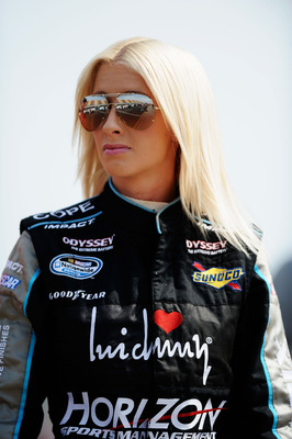 BROOKLYN, MI - JUNE 16:  Angela Cope, driver of the #124 Dillon Manufacturing & United Mobile Auctions Chevrolet, stands on the grid during qualifying for the NASCAR Nationwide Series Alliance Truck Parts 250 at Michigan International Speedway on June 16,
