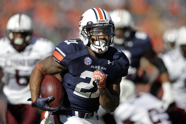 Nov 17, 2012; Auburn, AL, USA: Auburn Tigers running back Tre Mason (21) runs for a touchdown against the Alabama A&M Bulldogs at Jordan-Hare Stadium.  Mandatory Credit: John Reed-US PRESSWIRE