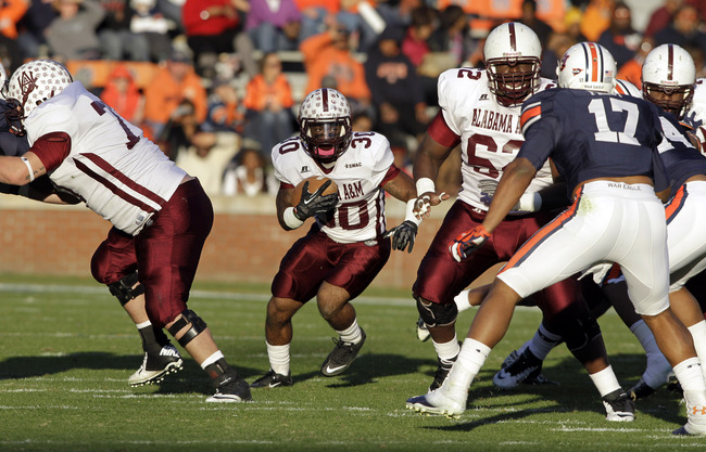 Nov 17, 2012; Auburn, AL, USA: Alabama A&M Bulldogs running back Brendan Johnson (30) carries against the Auburn Tigers during the second half at Jordan-Hare Stadium.  The Tigers beat the Bulldogs 51-7.  Mandatory Credit: John Reed-US PRESSWIRE