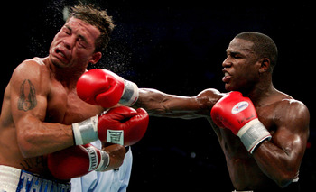 Mayweather (right) is pictured putting a horrible beatdown on Arturo Gatti.