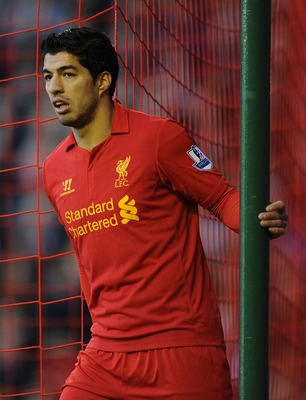 LIVERPOOL, ENGLAND - NOVEMBER 17:  Luis Suarez of Liverpool looks on during the Barclays Premier League match between Liverpool and Wigan Athletic at Anfield on November 17, 2012 in Liverpool, England.  (Photo by Chris Brunskill/Getty Images)