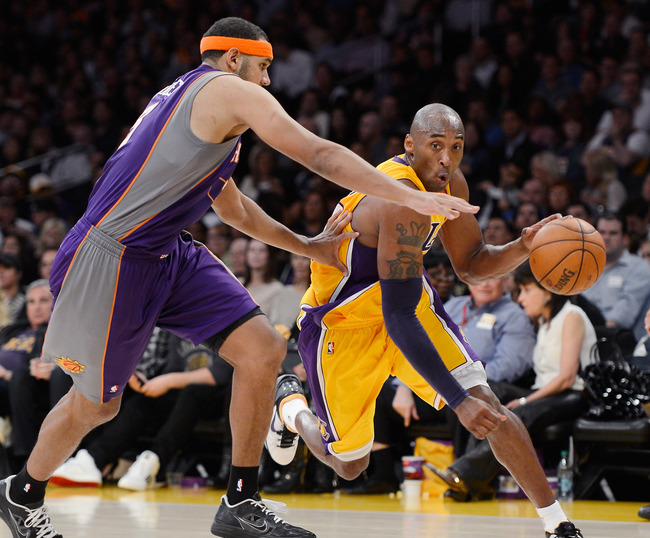 LOS ANGELES, CA - NOVEMBER 16:  Kobe Bryant #24 of the Los Angeles Lakers drives around Jared Dudley #3 of the Phoenix Suns during the basketball game at Staples Center on November 16, 2012 in Los Angeles, California. NOTE TO USER: User expressly acknowle