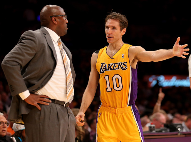 LOS ANGELES, CA - OCTOBER 30:  Head coach Mike Brown of the Los Angeles Lakers  confers with Steve Nash #10 in the game with the Dallas Mavericks at Staples Center on October 30, 2012 in Los Angeles, California.  The Mavericks won 99-91.  NOTE TO USER: Us