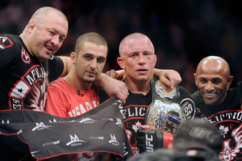 Nov 17, 2012; Montreal, QC, Canada;  Georges St-Pierre poses for a photo with his team after winning the Welterweight Championship bout against Carlos Condit at UFC 154 at the Bell Centre.  St-Pierre defeated Condit by unanimous decision.  Mandatory Credi