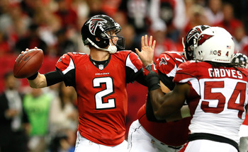 Cardinals LB Quentin Groves (right) brings the pressure on Matt Ryan.