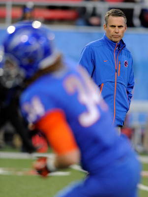 LAS VEGAS, NV - DECEMBER 22:  Head coach Chris Petersen of the Boise State Broncos watches his team warm up before playing the Arizona State Sun Devils in the MAACO Bowl Las Vegas at Sam Boyd Stadium December 22, 2011 in Las Vegas, Nevada. Boise State won
