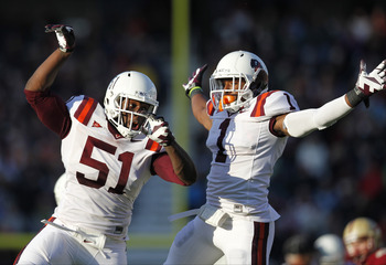 Nov 17, 2012; Chestnut Hill, Massachusetts, USA; Virginia Tech Hokies line backer Bruce Taylor (51) and cornerback Antone Exum (1) celebrate breaking up a pass during the third quarter against the Boston College Eagles at Alumni Stadium. Virginia Tech Hok