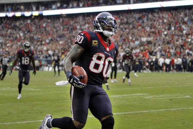 Nov 18, 2012; Houston, TX, USA; Houston Texans wide receiver Andre Johnson (80) scores a game winning touchdown against the Jacksonville Jaguars in overtime at Reliant Stadium. The Texans defeated the Jaguars 43-37. Mandatory Credit: Brett Davis-US PRESSW