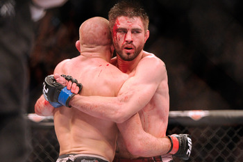 Nov 17, 2012; Montreal, QC, Canada;  Carlos Condit (right) embraces Georges St-Pierre after their Welterweight Championship bout at UFC 154 at the Bell Centre.  St-Pierre defeated Condit by unanimous decision.  Mandatory Credit: Eric Bolte-US PRESSWIRE