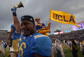 DE Datone Jones celebrates after the Bruins' win over USC