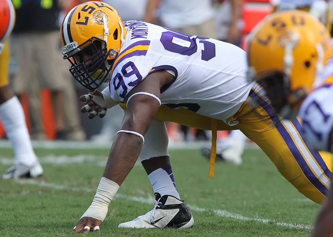 October 6, 2012; Gainesville FL, USA; LSU Tigers defensive end Sam Montgomery (99) gets ready to rush during the first quarter against the Florida Gators at Ben Hill Griffin Stadium. Mandatory Credit: Kim Klement-US PRESSWIRE