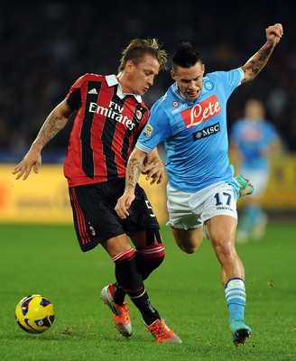 Philippe Mexès, battling away as ever