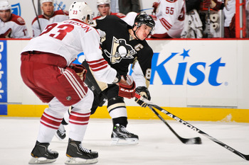 Ekman Larsson gets into position against Sydney Crosby of the Pittsburgh Penguins