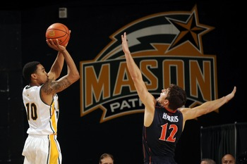 Nov 9, 2012; Fairfax, VA, USA; George Mason Patriots guard Sherrod Wright (10) attempts a jump shot over Virginia Cavaliers guard Joe Harris (12) during the first half at Patriot Center.  Mandatory Credit: Rafael Suanes-US PRESSWIRE