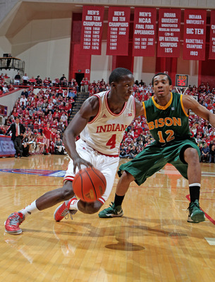 Nov 12, 2012; Bloomington, IN, USA; Indiana Hoosiers guard Victor Oladipo (4) drives to the basket against North Dakota State Bison guard Lawrence Alexander (12) at Assembly Hall. Mandatory Credit: Brian Spurlock-US PRESSWIRE