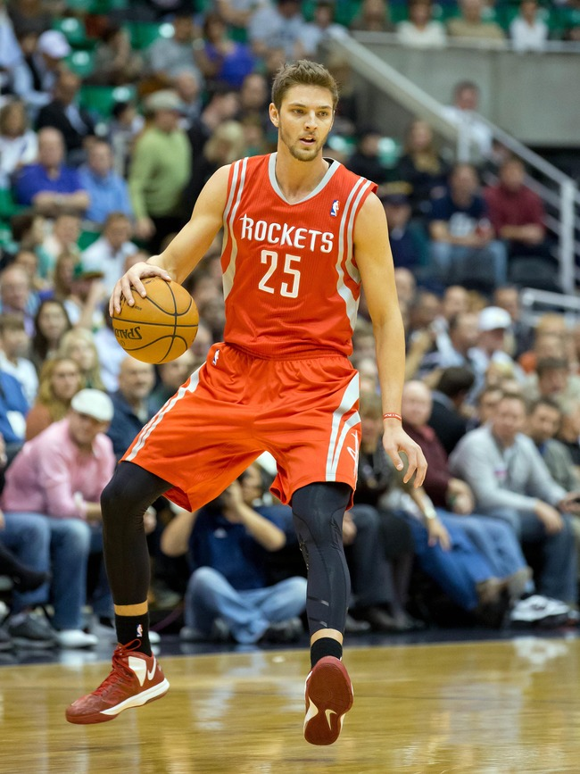 November 19, 2012; Salt Lake City, UT, USA; Houston Rockets small forward Chandler Parsons (25) controls the ball during the first quarter against the Utah Jazz at EnergySolutions Arena. Mandatory Credit: Russ Isabella-US PRESSWIRE