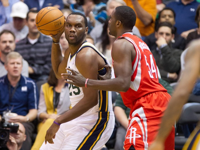 November 19, 2012; Salt Lake City, UT, USA; Utah Jazz center Al Jefferson (25) is defended by Houston Rockets power forward Patrick Patterson (54) during the first quarter at EnergySolutions Arena. Mandatory Credit: Russ Isabella-US PRESSWIRE