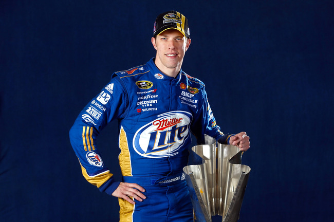 HOMESTEAD, FL - NOVEMBER 18:  NASCAR Sprint Cup Series Champion Brad Keselowski, driver of the #2 Miller Lite Dodge, poses with the Championship Trophy after the NASCAR Sprint Cup Series Ford EcoBoost 400 at Homestead-Miami Speedway on November 18, 2012 i