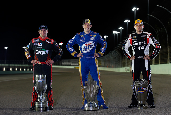 HOMESTEAD, FL - NOVEMBER 18:  Sprint Cup Champion Brad Keselowski (C), driver of the #2 Miller Lite Dodge, Nationwide Champion Ricky Stenhouse Jr. (L), driver of the #6 Cargill Ford, and Camping World Truck Series Champion James Buescher (R), driver of th
