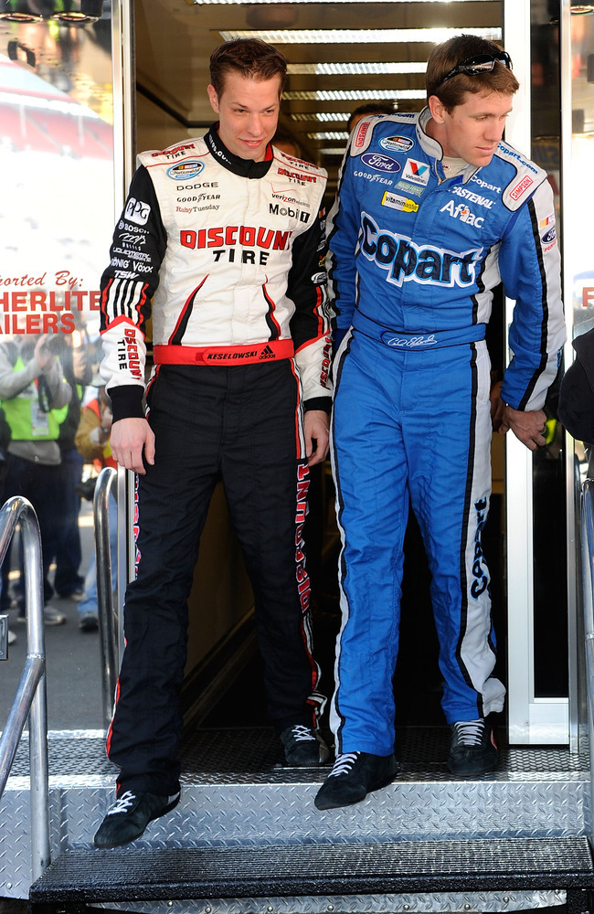 BRISTOL, TN - MARCH 20:  Carl Edwards (R), driver of the #60 COPART Ford, and Brad Keselowski, driver of the #22 Discount Tire Dodge, walk out of the NASCAR hauler at Bristol Motor Speedway on March 20, 2010 in Bristol, Tennessee.  (Photo by Rusty Jarrett