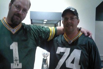 My brother and I stand in front of the Lombardi Trophy the Green Bay Packers earned in the 2010 season