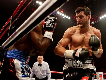 Carl Froch (right) bangs away at Yusaf Mack to end the fight in the third round.