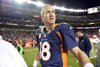 Manning hears cheers from Broncos fans after beating San Diego.