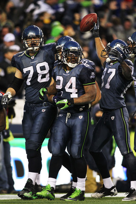 Seahawks congratulate Marshawn Lynch after his touchdown run vs. the Saints in a 2010 playoff game.