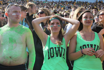 IOWA CITY, IA- SEPTEMBER 22:  Dejected fans of the Iowa Hawkeyes watch the final seconds of the fourth quarter against the Central Michigan Chippewas on September 22, 2012 at Kinnick Stadium in Iowa City, Iowa.  Central Michigan defeated Iowa 32-31.  (Pho