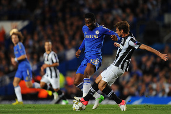 LONDON, ENGLAND - SEPTEMBER 19: John Obi Mikel of Chelsea  is tackled by Claudio Marchisio of Juventus  during the UEFA Champions League Group E match between Chelsea and Juventus at Stamford Bridge on September 19, 2012 in London, England.  (Photo by Mik