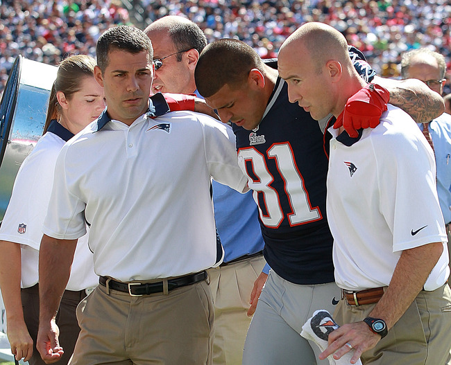 FOXBORO, MA - SEPTEMBER 16:   Aaron Hernandez #81 of the New England Patriots is taken from the field after suffering an injury against Arizona Cardinals in the first half at Gillette Stadium on September 16, 2012 in Foxboro, Massachusetts. (Photo by Jim