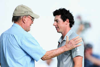 Pete Dye, left, congratulates Rory McIlroy.