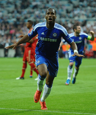MUNICH, GERMANY - MAY 19:  Didier Drogba of Chelsea celebrates after scoring his team's first goal during UEFA Champions League Final between FC Bayern Muenchen and Chelsea at the Fussball Arena München on May 19, 2012 in Munich, Germany.  (Photo by Laure