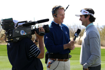 Rich Lerner shares a laugh with Bubba Watson during an interview.