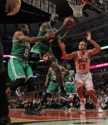 CHICAGO, IL - NOVEMBER 12: Kevin Garnett #5 of the Boston Celtics rebounds between teammate Rajon Rondo #9 and Joakim Noah #13 of the Chicago Bulls at the United Center on November 12, 2012 in Chicago, Illinois. The Celtics defeated the Bulls 101-95. NOTE