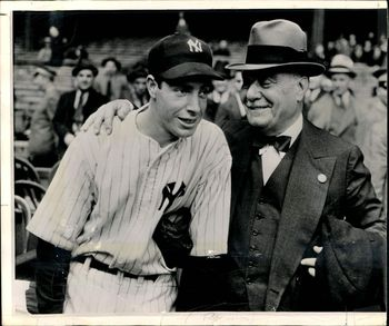 The Colonel and Joe DiMaggio. Image via The Sporting News.