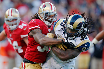 SAN FRANCISCO, CA - NOVEMBER 11:  Safety Dashon Goldson #38 of the San Francisco 49ers tries to strip the ball out of the arms of running back Steven Jackson #39 of the St. Louis Rams in the fourth quarter on November 11, 2012 at Candlestick Park in San F