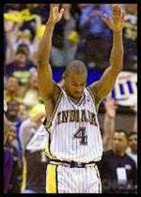 Travis Best raises his arms in triumph after drilling a three with 16 seconds left to help Indiana beat Milwaukee 96-95 in Game 5 of their first-round series in 2000.