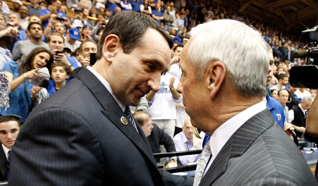 DURHAM, NC - MARCH 03:  (L-R) Head coach Mike Krzyzewski of the Duke Blue Devils greets head coach Roy Williams of the North Carolina Tar Heels before their game at Cameron Indoor Stadium on March 3, 2012 in Durham, North Carolina.  (Photo by Streeter Lec