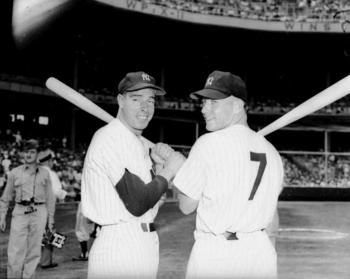 Joe DiMaggio, left, played center field for the Yankees for 13 seasons. Mickey Mantle succeeded the Yankee Clipper and played the position for 15 seasons. Photo by Charles Hoff/NY Daily News Archive via Getty Images