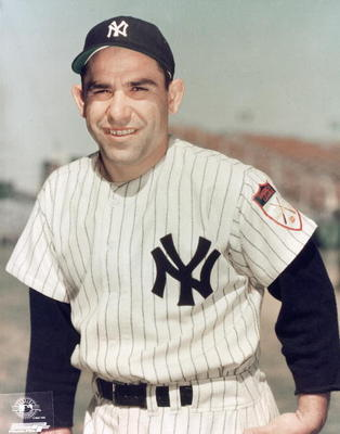 "This 1951 photo of Yogi Berra shows the iconic interlocked ""NY"" logo on the cap and uniform. Photo by Photo File/MLB Photos via Getty Images"