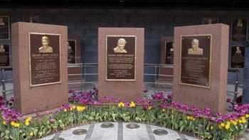 The first monument placed in center field by the New York Yankees was for former manager Miller Huggins, center, in 1932. The monuments for Huggins, Lou Gehrig, left, and Babe Ruth are at the center of Monument Park in the new Yankee Stadium. Photo by: Diamond Images/Getty Images