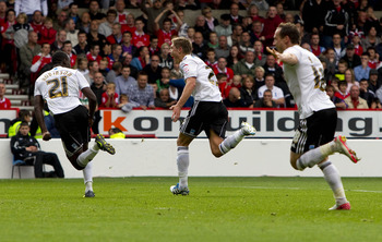 Hendrick (centre) after scoring