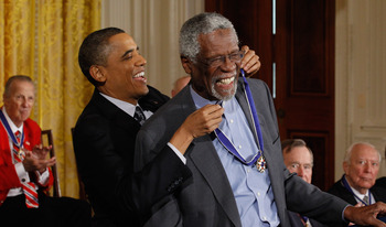 That's right, the President puts on Bill Russell's bling.