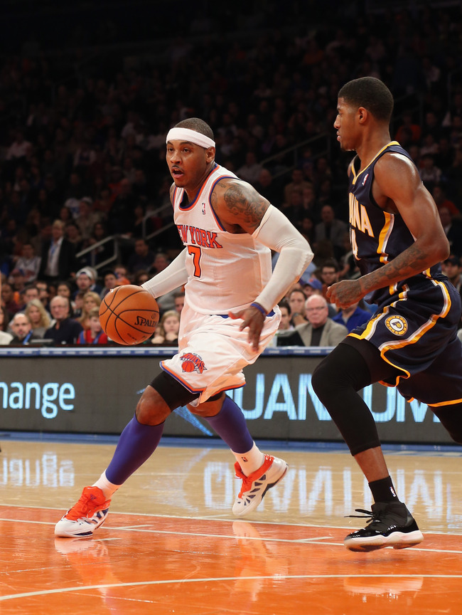 NEW YORK, NY - NOVEMBER 18: Carmelo Anthony #7 of the New York Knicks dribbles the ball against the Indiana Pacers at Madison Square Garden on November 18, 2012 in New York City. NOTE TO USER: User expressly acknowledges and agrees that, by downloading an