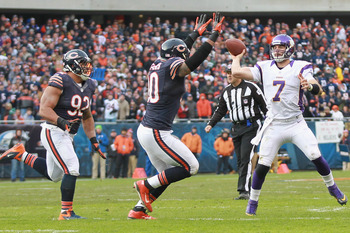 CHICAGO, IL - NOVEMBER 25: Christian Ponder #7 of the Minnesota Vikings passes the ball against Julius Peppers #90 and Stephen Paea #92 of the Chicago Bears at Soldier Field on November 25, 2012 in Chicago, Illinois.  (Photo by Dilip Vishwanat/Getty Image