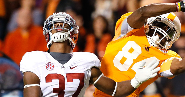 KNOXVILLE, TN - OCTOBER 20:  Cordarrelle Patterson #84 of the Tennessee Volunteers pulls in this reception against Robert Lester #37 of the Alabama Crimson Tide at Neyland Stadium on October 20, 2012 in Knoxville, Tennessee.  (Photo by Kevin C. Cox/Getty