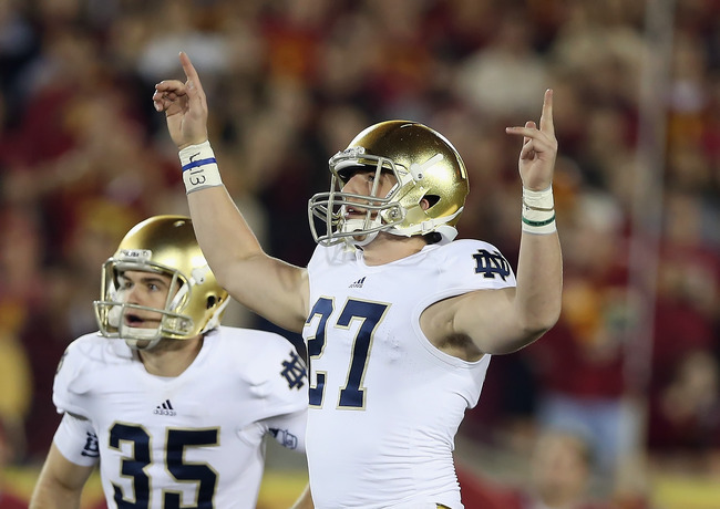 LOS ANGELES, CA - NOVEMBER 24:  Kicker Kyle Brindza #27 of the Notre Dame Fighting Irish celebrates field goal at the end of the first half against the USC Trojans at Los Angeles Memorial Coliseum on November 24, 2012 in Los Angeles, California.  (Photo b